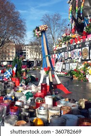 Paris, France - December 28th , 2015: The statue of Place de la Republique is turned to a memorial site to remember those who were killed during the Paris attacks in Paris.