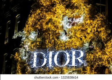PARIS, FRANCE - DECEMBER 29, 2018: Paris Christian Dior flagship headquarters fashion store on Avenue Montaigne. Dior boutique decorated with illuminated Christmas tree.