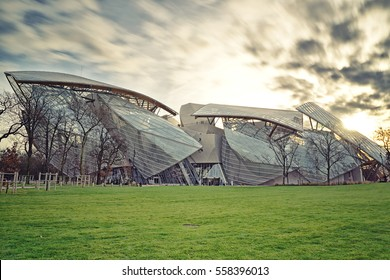 PARIS, FRANCE - DECEMBER 30, 2015: Foundation Louis Vuitton in the Golden Hour, sunset. This new museum in Paris displays modern art and special exhibitions. Museum close to Jardin d'Acclimatation.