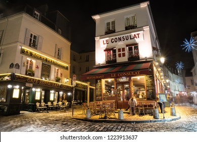 PARIS, FRANCE -  December 30, 2017. View of typical paris cafe Paris. Montmartre area is among most popular destinations in Paris, Le Consulat is a typical cafe. Night scene.