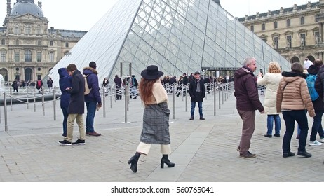 PARIS, FRANCE - DECEMBER, 31, 2016. Crowded square near the Louvre entrance, famous French museum and popular touristic destination