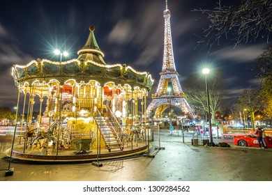 Paris, France - December 4, 2018 - Eiffel Tower and carousel in Paris at night