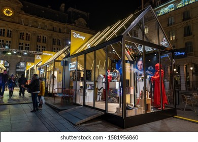 Paris, France - December 4, 2019: Christmas Pop-up transparent store of Disney, Withings, L'or outside trainstation Gare de St Lazare