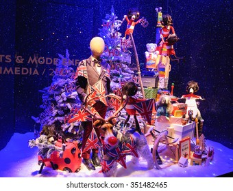 PARIS, FRANCE - DECEMBER 6, 2015: Colorful Christmas decoration in the windows of BHV department store (located near Hotel de Ville City Hall) attracts Parisian children and tourists.