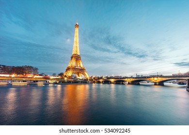 PARIS, FRANCE - DECEMBER 7, 2016:  Eiffel Tower (Tour Eiffel) illuminated at night. It's a wrought iron lattice tower named after the engineer Gustave Eiffel