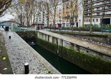 Paris, France - December 8, 2017: Old canal system in the district of St. Martin, now converted into a park, Paris, France