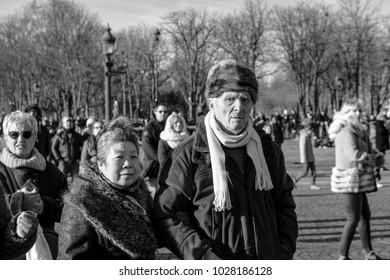 Paris, France - December 9 2017: Interracial couple strolling in Place de la Concorde