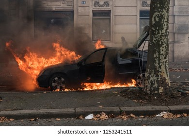 Paris, FRANCE - Decembrer 8 2018 : a Car burning during the riots of the Gilets jaunes (Yellows jackets) in Paris.