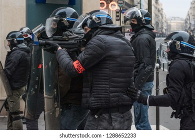 "Paris, FRANCE - Decembrer 8 2018 : Policeman with a flash-ball, LBD, control protesters Yellow Vest ""Gilets Jaunes"" at Paris"