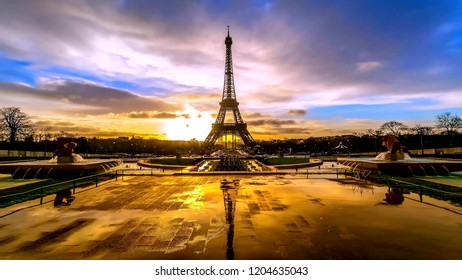 Paris  , France , Eiffel tower ,  Tourist surrounding one of the most famous monuments of Paris