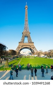 Paris, France, Europe. Mar 3, 2018: Cityscape of Eiffel Tower and many people come in to visit. Travel to famous Paris landmarks on a winter. Blue sky with clouds in autumn. Romantic travel background