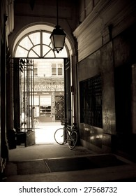 Paris, France, Europe, October 2008 - Black and white image of a single bicycle leaning against the gate of a passage in Paris.