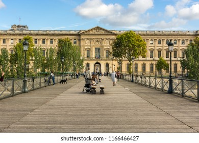 Paris, France, Europe - September 16, 2017:  Pont des Arts or Arts Bridge, between  the Louvre Museum and France Institute whith cloudy blue sky