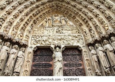 Paris, France - famous Notre Dame cathedral facade saint statues. UNESCO World Heritage Site.