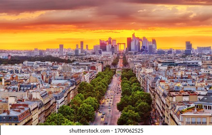 Paris, France. Fantastic view of business district of Paris during dramatic sunset. Panorama of city streets from above, fascinating summer season in the most romantic World Capital city Paris.