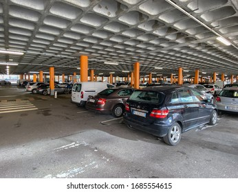 Paris, France - FEB 11, 2020: Multiple cars parked in large parking of a supermarket mall in French city, Mercedes, Skoda, Peugeot, Volkswagen