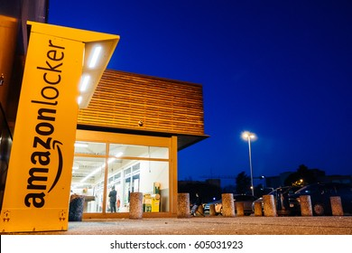PARIS, FRANCE - FEB 15, 2017: View from below of Amazon locker orange delivery package locker at dusk - Amazon Locker is a self-service parcel delivery service offered by online retailer Amazon.com.