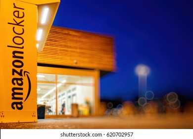 PARIS, FRANCE - FEB 15, 2017: Amazon locker orange delivery package locker at dusk - Amazon Locker is a self-service parcel delivery service offered by online retailer Amazon.com.