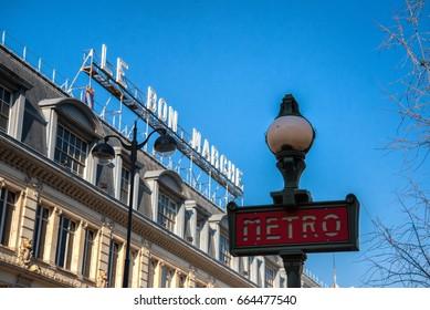 PARIS, FRANCE - FEB 19: Metro station sign across the Le Bon Marche department store on February 19, 2013. Le Bon Marche was first ever modern department store in Paris.