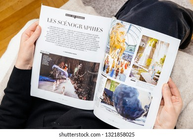Paris, France - Feb 23, 2019: Woman reading French magazine covering Karl Lagerfeld death, iconic fashion designer died aged 85 - scenography made for the shows article