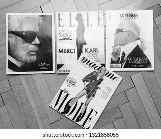 Paris, France - Feb 23, 2019: Multiple French tribute magazines arranged on the parquet wooden floor, covering Karl Lagerfeld death, iconic fashion designer died aged 85