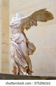 PARIS, FRANCE - FEBRUARY 06, 2016: Winged Victory of Samothrace, called Nike of Samothrace, marble sculpture in Louvre Museum