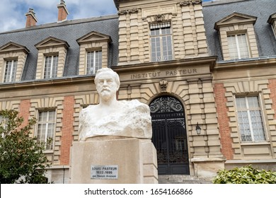 Paris, France - February 09 2020: Pasteur bust in front of the Old building of the Pasteur institute in Paris. Sculpture is from Naoum Aronson (1872 1943)