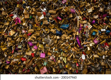 PARIS, FRANCE - February 1, 2014: Love locks on the Pont des Arts pedestrian bridge. The padlocks which sweethearts typically lock to a bridge are seen controversial by the authorities.