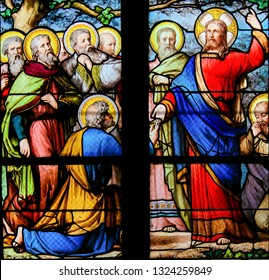 Paris, France - February 10, 2019: Stained Glass in the Church of Saint Severin, Latin Quarter, Paris, France, depicting Jesus handing over the Keys to the Kingdom of Heaven to Saint Peter