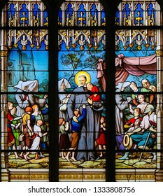 Paris, France - February 10, 2019: Stained Glass in the Church of St Severin, Latin Quarter, Paris, depicting Saint Vincent de Paul, a French Catholic saint who dedicated himself to serving the poo
