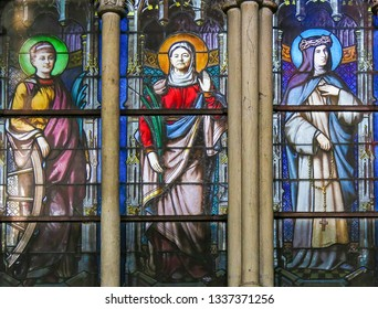 Paris, France - February 10, 2019: Stained Glass in the Church of Saint Severin, Latin Quarter, Paris, France, depicting Catholic Saints, including St Catherine aof Alexandria