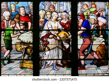 Paris, France - February 10, 2019: Stained Glass in the Church of Saint Severin, Latin Quarter, Paris, France, depicting Salome and the head of St John the Baptist on a plate