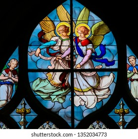 Paris, France - February 10, 2019: Stained Glass in the Church of Saint Severin, Latin Quarter, Paris, France, depicting Angels