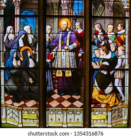 Paris, France - February 10, 2019: Stained Glass in the Church of Saint Severin, Latin Quarter, Paris, France, depicting Saint Francois de Sales, bishop of Geneva.