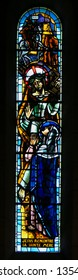 Paris, France - February 11, 2019: Stained Glass in the Basilica Sacre Coeur in Paris, France, depicting Jesus meeting Mary on the Via Dolorosa