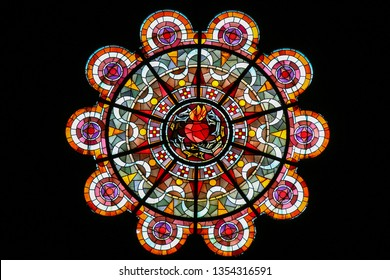 Paris, France - February 11, 2019: Stained Glass in the Basilica Sacre Coeur in Paris, France, depicting the Sacred Heart of Jesus