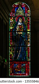 Paris, France - February 11, 2019: Stained Glass in the Basilica Sacre Coeur in Paris, France, depicting St. Margaret Mary Alacoque