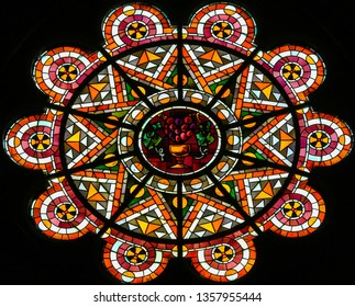 Paris, France - February 11, 2019: Stained Glass in the Basilica Sacre Coeur in Paris, France, depicting a wine cup, symbol of the Blood of Christ