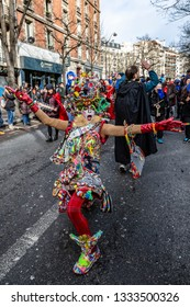 Paris, France - February 11,2018: A disguised person dancing in the street during the Carnaval de Paris 2018.
