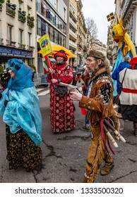 Paris, France - February 11,2018: Group of disguised people walking in the street during the Carnaval de Paris 2018.