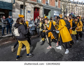 Paris, France - February 11,2018: Image of a group of musicants  perfoming in the street during the Carnaval de Paris 2018.