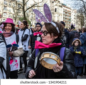Paris, France - February 11,2018: Portrait of woman musicant perfoming in the street during the Carnaval de Paris 2018.