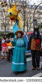 Paris, France - February 11,2018: Two disguised people walking in the street during the Carnaval de Paris 2018.
