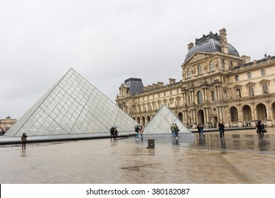PARIS, FRANCE - FEBRUARY, 13, 2016: Louvre Museum on the stormy rainy day in a winter season
