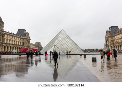 PARIS, FRANCE - FEBRUARY, 13, 2016: Louvre Museum on the stormy rainy day in a winter season.
