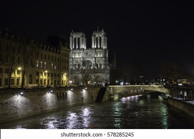 PARIS, FRANCE- February 14, 2014 : Notre Dame de Paris cathedral at night is one of the most visited places in Paris