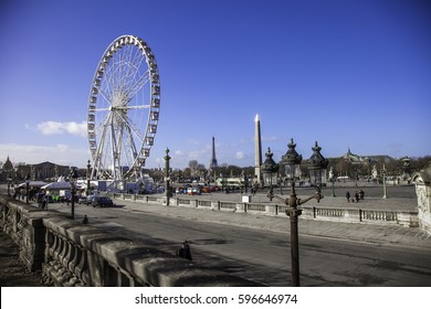 PARIS, FRANCE- February 14, 2014: Fairy wheel Tuileries Garden (Jardin des Tuileries) is a public garden located between the Louvre Museum and the Place de la Concorde