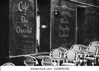 PARIS, FRANCE - FEBRUARY 14, 2019: Traditional Parisian cafe Le Mouffetard on famous Mouffetard street which is popular open market and nightlife street in Latin Quarter. Terrace. Black white photo.