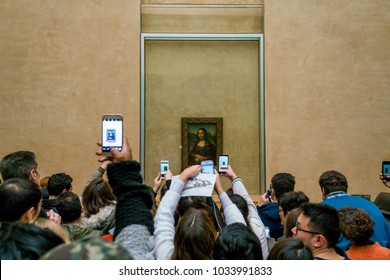 "PARIS, FRANCE - FEBRUARY 15, 2018: Visitors take photo of Leonardo DaVinci's ""Mona Lisa"" at the Louvre Museum"