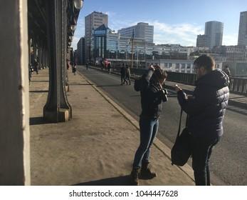 Paris, France / February 18th 2018: Girl wearing a digital camera